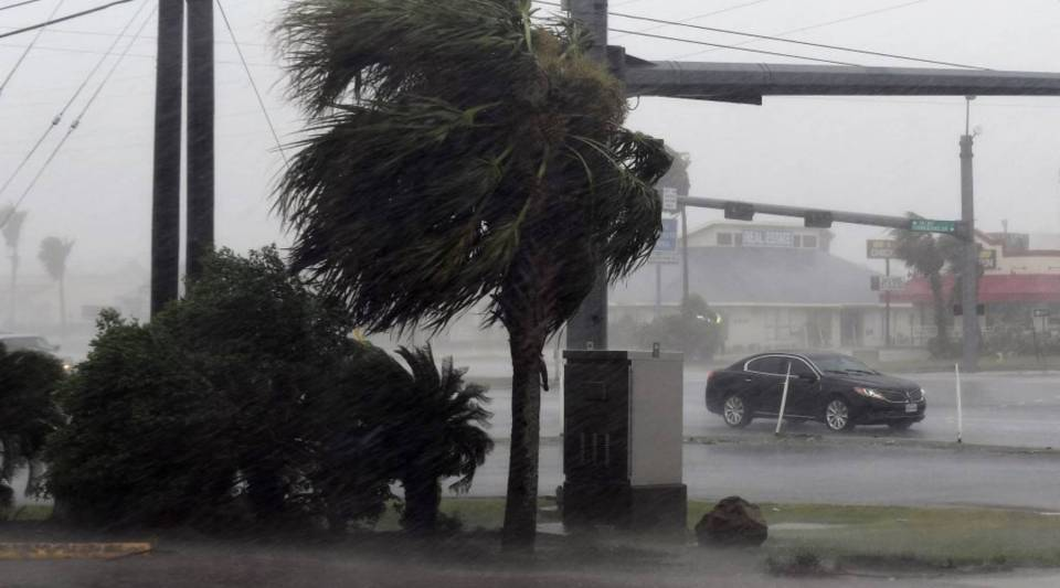 A motorist drives through heavy rain before the approaching Hurricane Harvey hits Corpus Christi, Texas, on Friday.