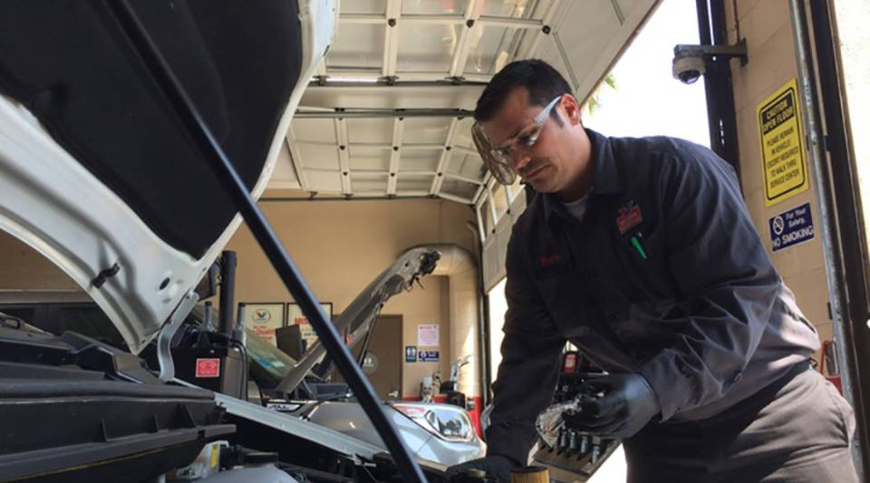 Matthew Moreno works on a vehicle at a Valvoline Instant Oil Change in Los Angeles.