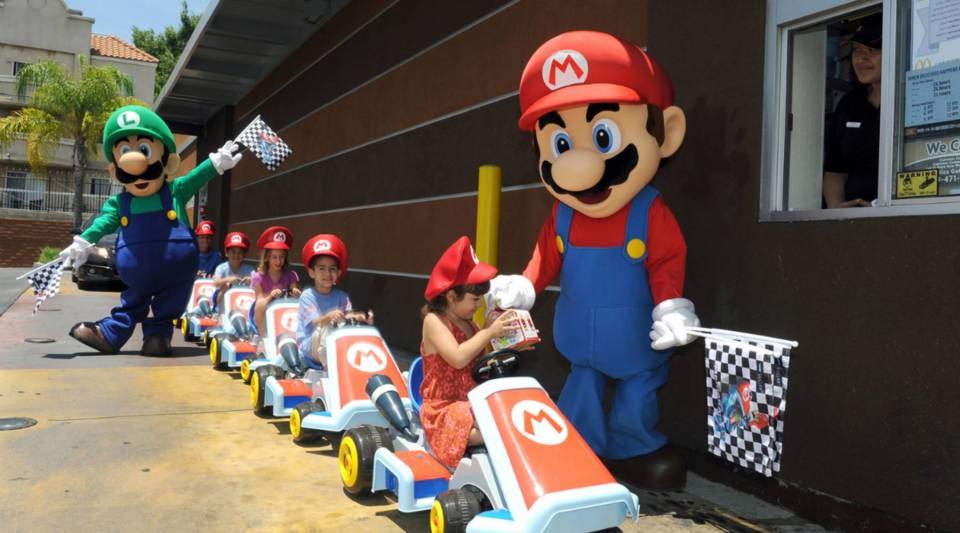 Mario and Luigi direct children ride through a McDonald's drive-thru in Los Angeles, California.