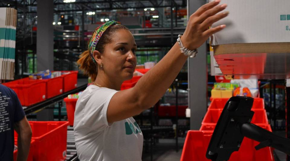 Veronica Mena works for the e-retailer Boxed in its Union, New Jersey, warehouse.