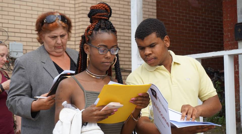 Chayne Rouse and his sister Kayla Wilkes wait in line to apply for jobs at Pure Penn.
