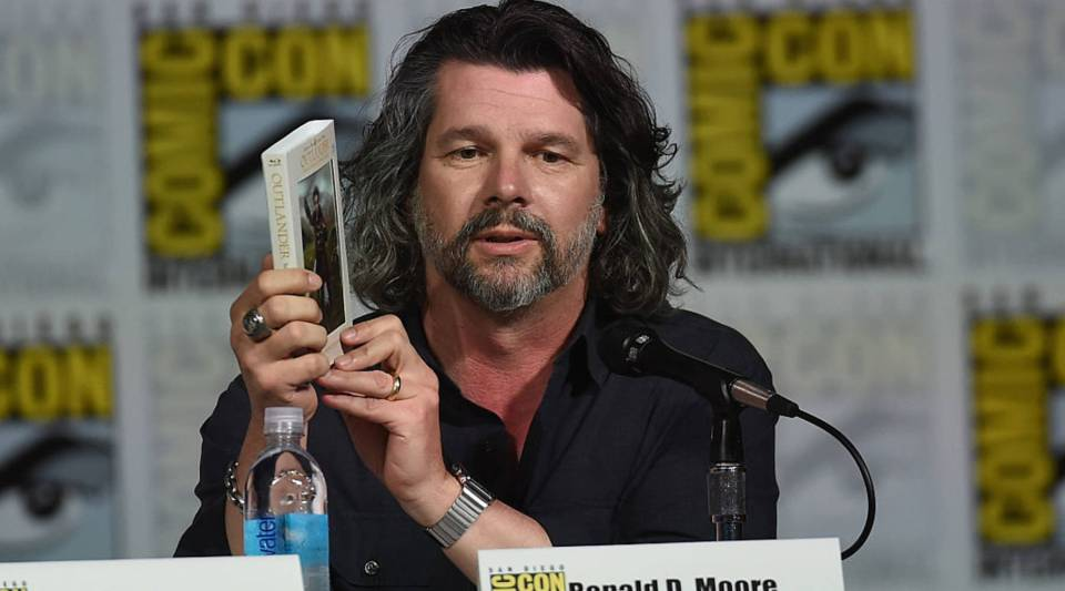 "Writer-producer Ronald D. Moore's latest stint is with the time-traveling ""Outlander."" His earlier work includes ""Star Trek: The Next Generation"" and the reboot of ""Battlestar Galactica."" Above, Moore speaks at a 2015 Comic-Con panel in San Diego, California."