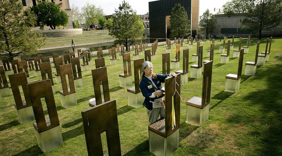 Jane Thomas, collections manager at the Oklahoma City National Memorial, tends to one of the chairs representing the 168 people killed in the 1995 bombing of the Alfred P. Murrah Federal Building the day prior to the 10th anniversary of the explosion.
