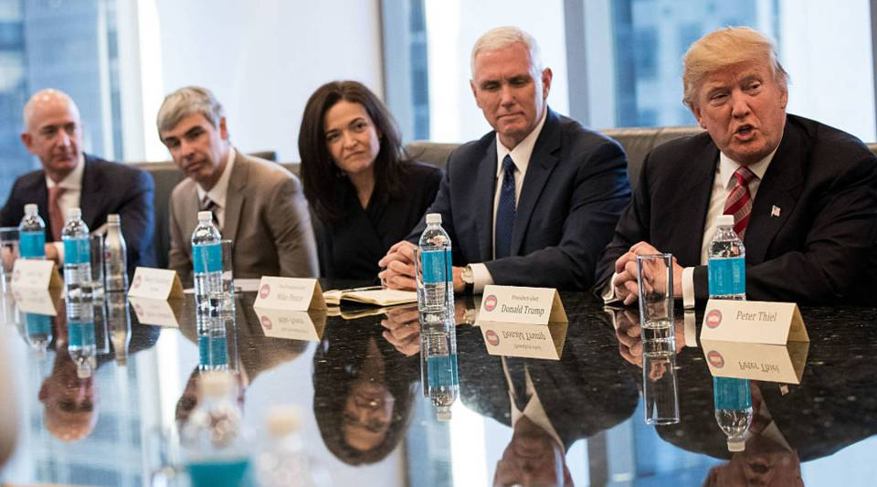 (L to R) Jeff Bezos, chief executive officer of Amazon, Larry Page, chief executive officer of Alphabet Inc. (parent company of Google), Sheryl Sandberg, chief operating officer of Facebook, Vice President Mike Pence listen as President Donald Trump speaks during a meeting of technology executives at Trump Tower on December 2016 in New York City.