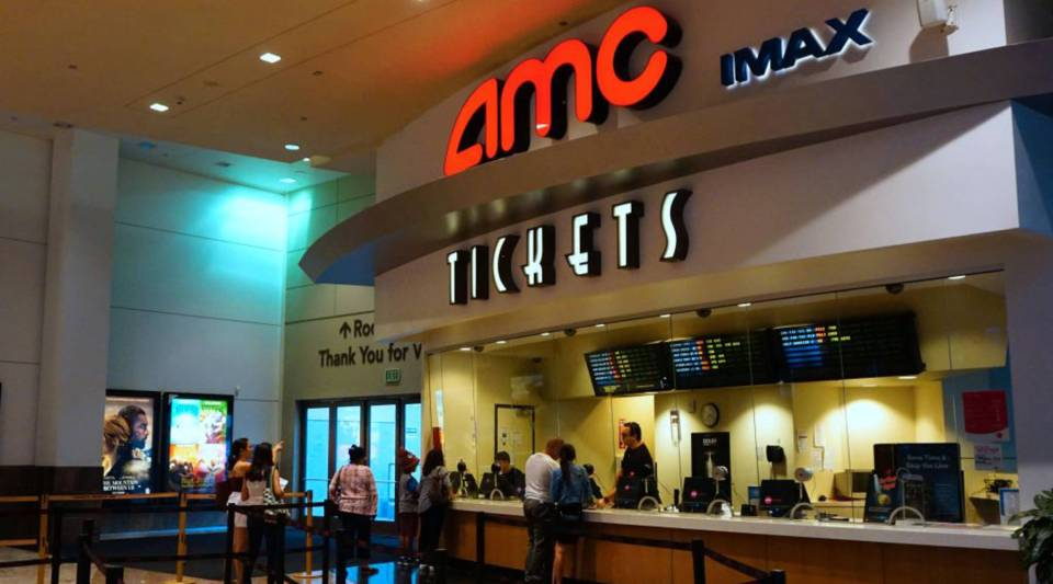 Moviegoers purchase tickets at an AMC theater in Arcadia, California, in August.