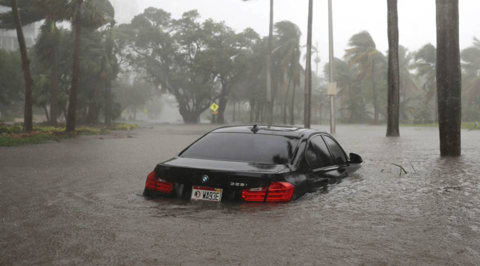 A car is seen in a flooded street as Hurricane Irma passes through on September 10, 2017 in Miami, Florida.