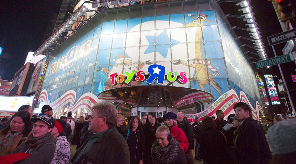 """People gather outside Toys """"R"""" Us for Black Thursday in Times Square back in 2012 in New York City."""