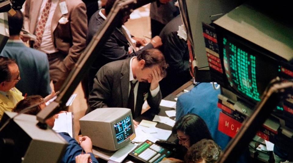 A trader on the New York Stock Exchange reacts on Oct. 19, 1987, as stocks are devastated during one of the most frantic days in the exchange's history. The Dow Jones index plummeted over 200 points in record trading.