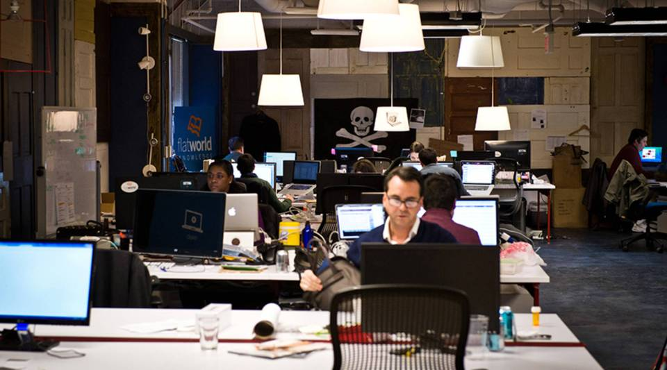 Employees of startup companies work at the offices of a business incubator in Washington, D.C.