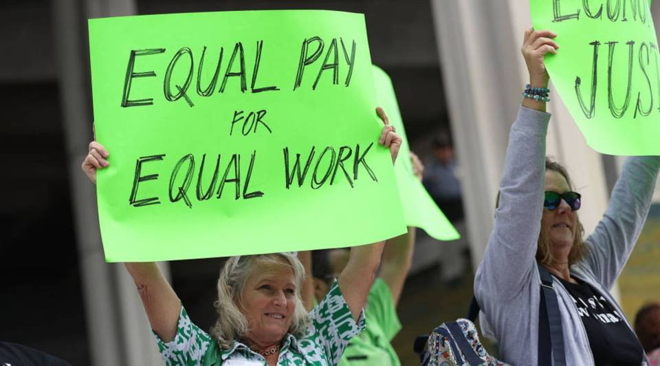 Protesters demand that woman be paid the same as their male co-workers in March in Fort Lauderdale, Florida.