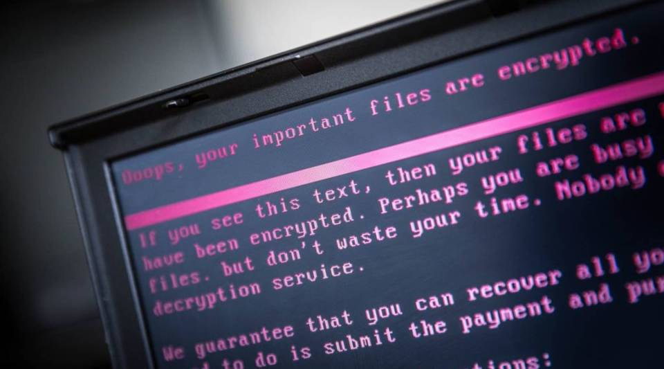 A laptop displays a message after being infected by a ransomware as part of a worldwide cyberattack.