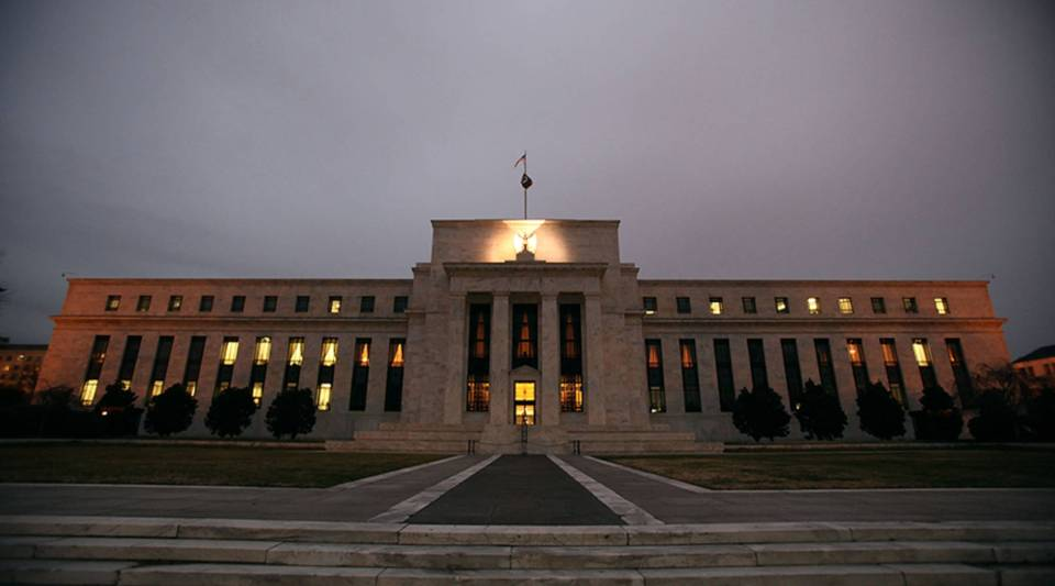 Flags fly over the Federal Reserve Building on December 16, 2008 in Washington, D.C.