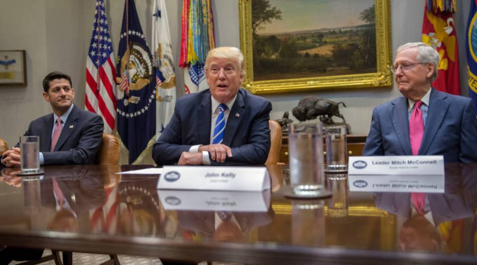President Donald Trump (C), with Speaker of the House Paul Ryan (L) and Senate Majority Leader Mitch McConnell (R), delivers remarks during a meeting with members of Congress and his administration regarding tax reform in the Roosevelt Room of the White House on Sept. 5  in Washington, DC.