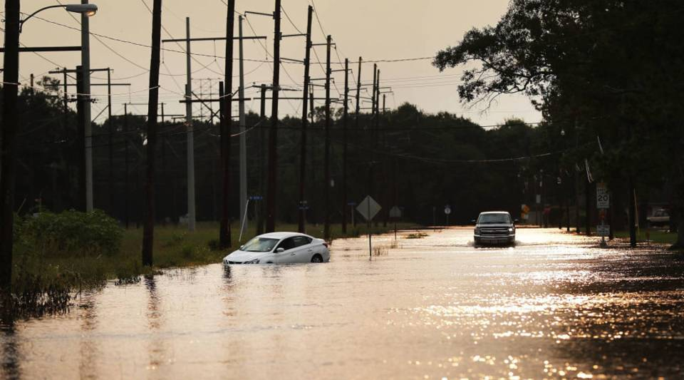 A truck drives through high water along a street in Orange, Texas, on Sept. 6, more than a week after Hurricane Harvey made landfall.