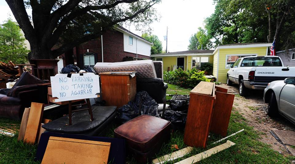 Jean Olson's home in Bellaire is one of many on her street that is inside-out. Even family heirlooms are in her front yard because her house is still uninhabitable.