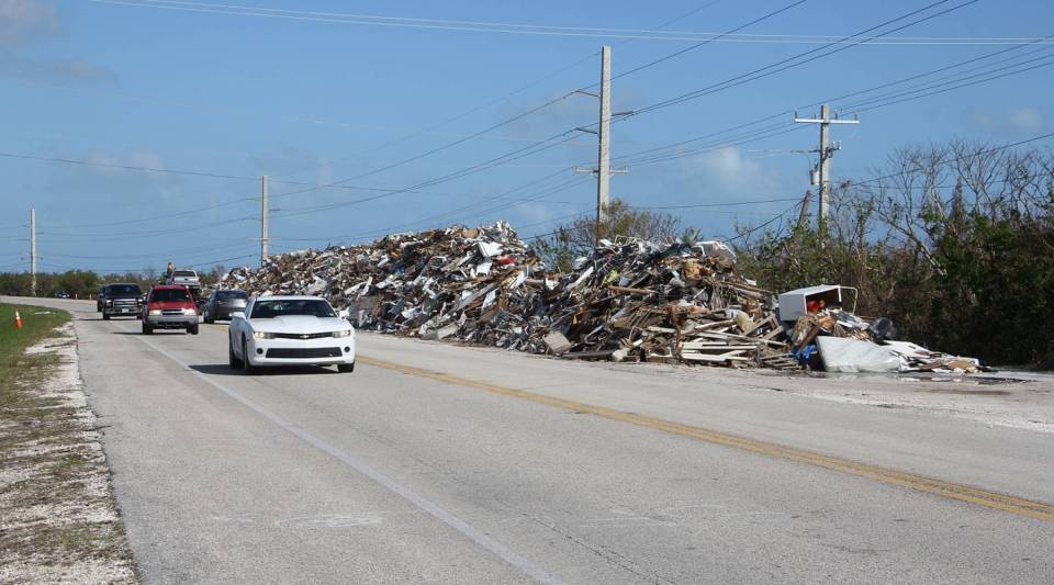 Most visitors reach Key West by driving down U.S. 1 — since Hurricane Irma, that has meant the once-scenic highway is now lined with debris piles like this one on Ramrod Key.