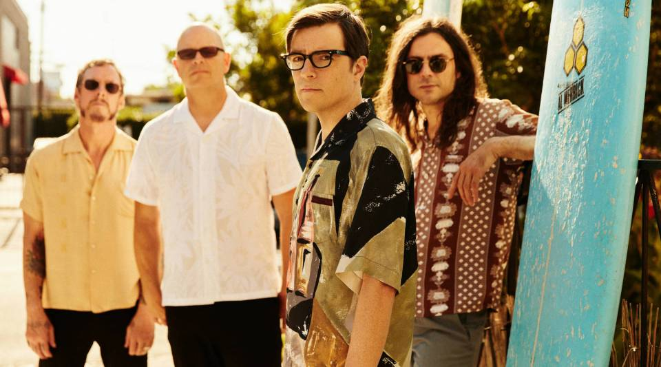Rivers Cuomo (second from right) said the most surprising thing about being a musician is the amount of time spent in front of a computer.