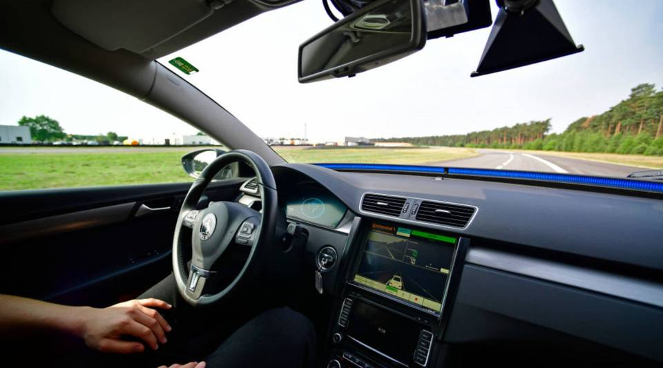 A driver presents a Cruising Chauffeur, a hands free self-driving system designed for motorways.