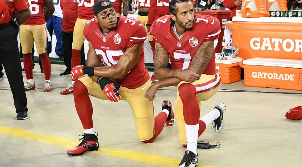 Colin Kaepernick (R), and Eric Reid of the San Francisco 49ers (L), kneel in protest during the national anthem prior to playing the Los Angeles Rams at Levi's Stadium on Sept. 12, 2016 in Santa Clara, California.