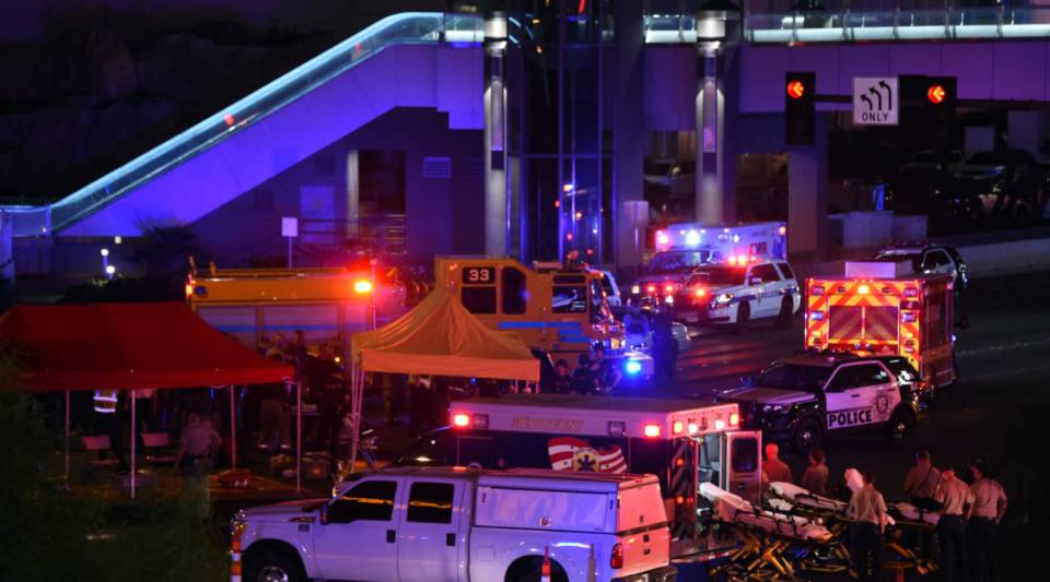 Police and rescue personnel gather at the intersection of Las Vegas Boulevard and Tropicana Ave. in Las Vegas, Nevada after a mass shooting at a nearby country music festival.