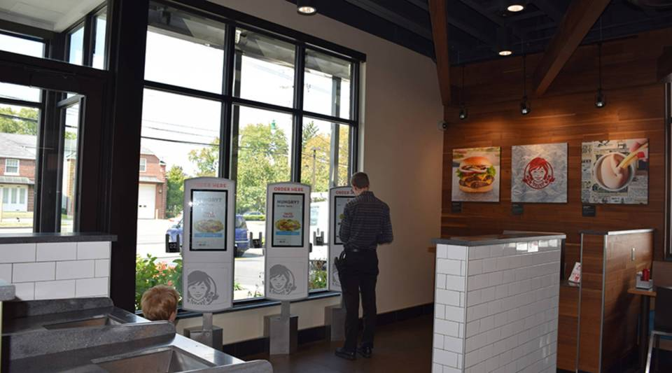 The Wendy's in the Clintonville neighborhood of Columbus, Ohio, has a flat screen TV, an outdoor patio, printed menus and electronic ordering kiosks.