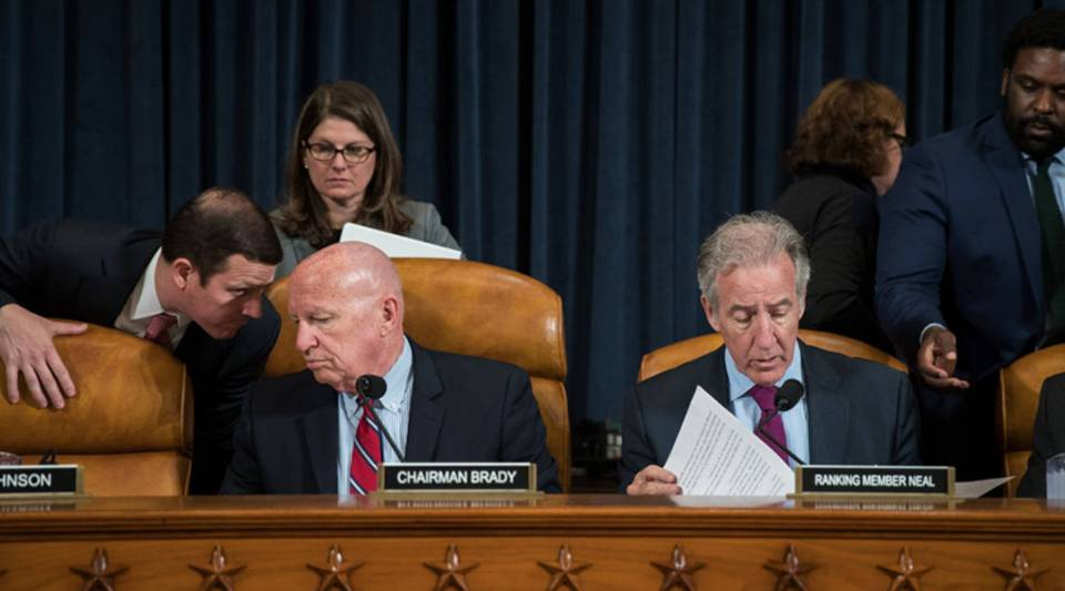 Committee chairman Rep. Kevin Brady (R-TX) and ranking member Rep. Richard Neal (D-MA) confer with aides before the start of a House Ways and Means Committee hearing concerning the Trump administration's fiscal year 2018 budget proposals, on Capitol Hill, May 24, 2017 in Washington, DC.