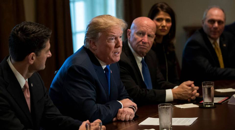 President Donald Trump speaks to the House Ways and Means Committee about tax reform legislation yesterday at the White House, flanked by Speaker of the House Paul Ryan, left, and committee Chairman Kevin Brady.