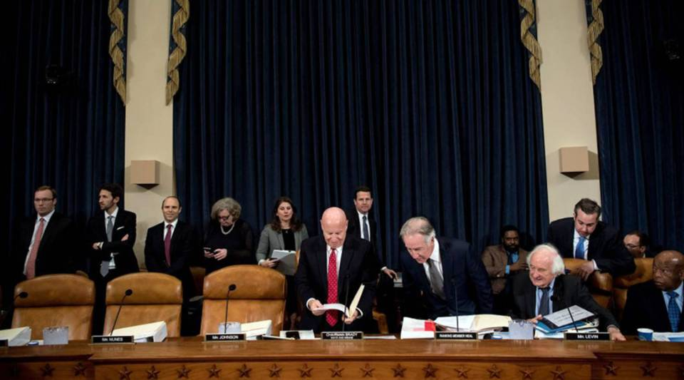 House Ways and Means Committee Chairman Kevin Brady (R-TX), center, and others arrive for a markup of the Tax Cuts and Jobs Act on Capitol Hill on Nov. 6.