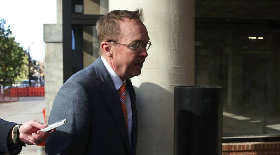 White House Budget Director Mick Mulvaney, President Donald Trump's pick for acting director of the Consumer Financial Protection Bureau, walks back to the White House from the CFPB building after he showed up for his first day of work today in Washington, D.C.