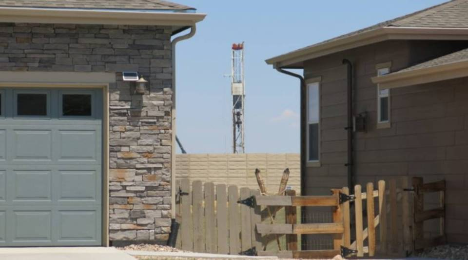 A drilling rig near homes in Erie, Colorado.