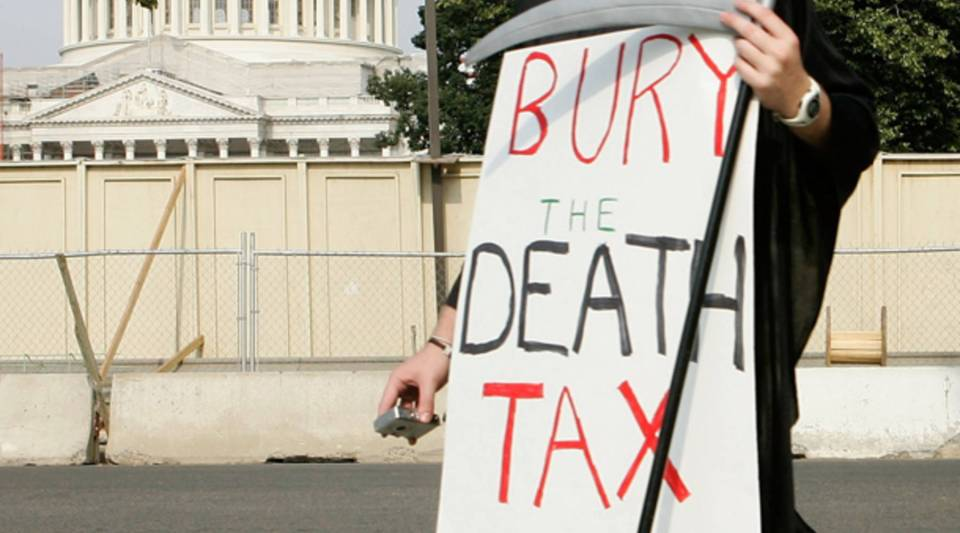 A member of College Republicans National Committee dresses as Grim Reaper as he marches on Capitol Hill to call on the Senate to eliminate the death tax June 8, 2006 in Washington, D.C.