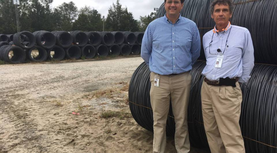 Right to left: MAR-MAC INC. CEO John Martin and his son Jarrett Martin use raw steel produced in the U.S. and abroad at the plant in McBee, S.C.
