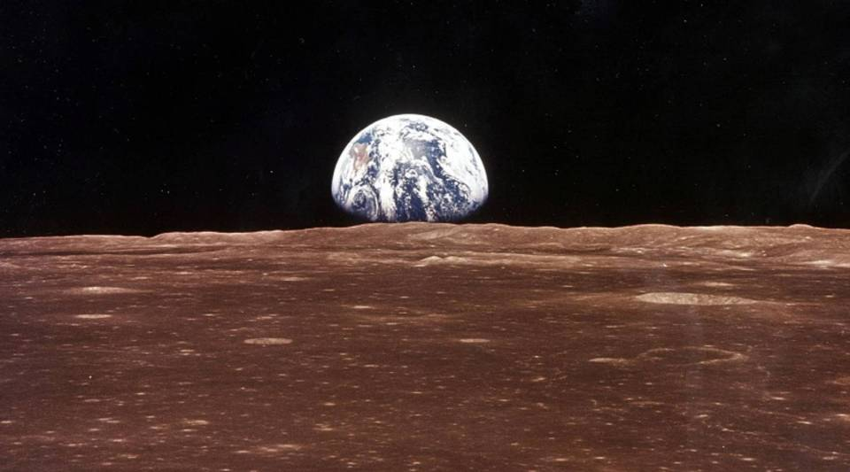 A view of Earth appears over the lunar horizon from Apollo 11 before astronauts Neil Armstrong and Edwin Aldrin Jr. made their historic moon walk.