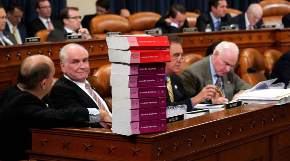 House Ways and Means Committee member Rep. Tom Reed (R-NY) keeps a stack of books that document the current federal tax code and related regulations on his desk.