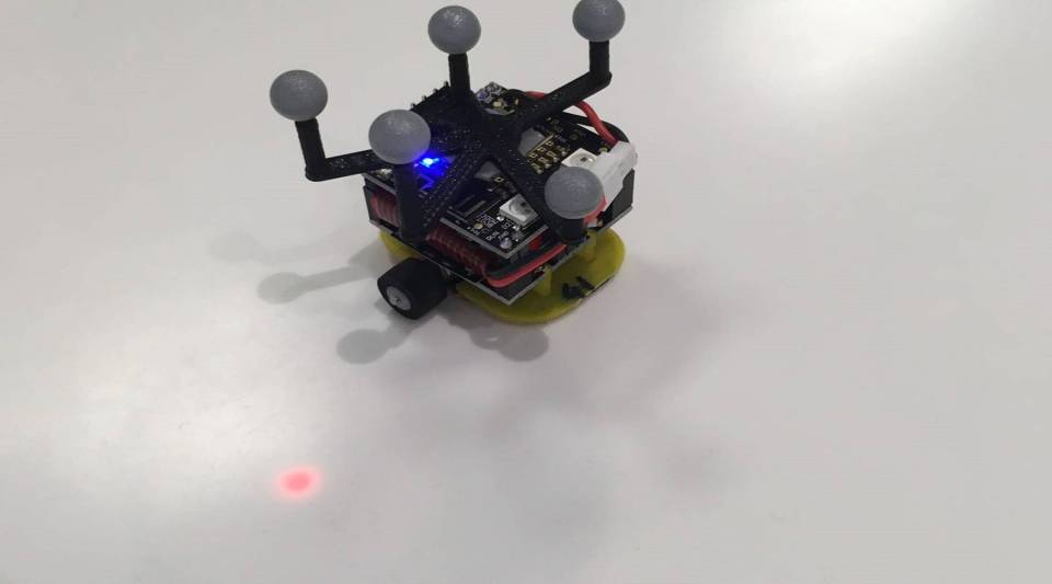 The Robotarium has about 100 ground robots that glide along a white surface. Each has a Wi-Fi chip on top and small rubber wheels on the bottom.