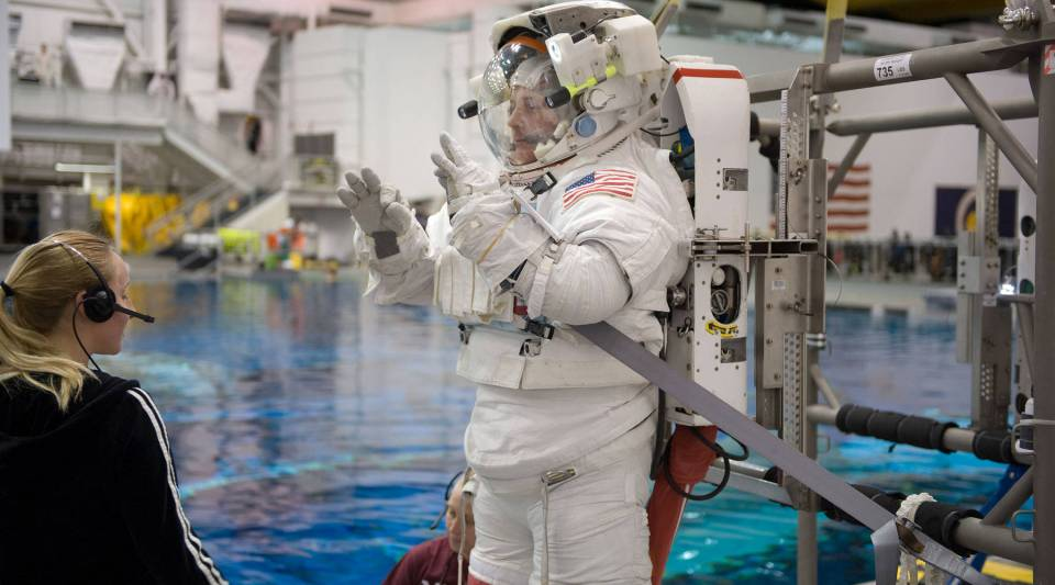 Attired in a training version of his spacesuit, astronaut Doug Wheelock, Expedition 24 flight engineer and Expedition 25 commander, awaits the start of a spacewalk training session in the waters of the Neutral Buoyancy Laboratory near NASA's Johnson Space Center in Houston.