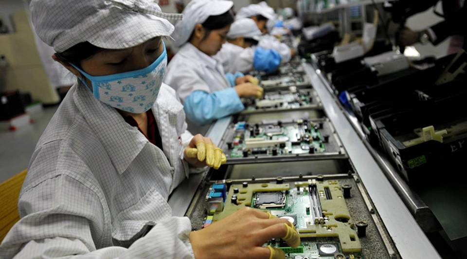 Chinese workers assemble electronic components at the Taiwanese technology giant Foxconn's factory in Shenzhen, in the southern Guangzhou province.