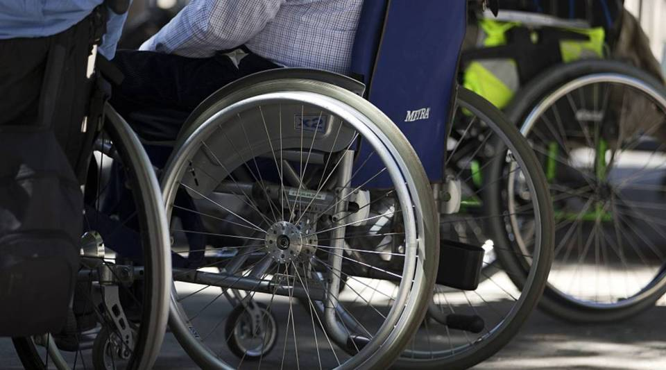 Disabled individuals in wheelchairs take part in a demonstration to demand more accessibility options for disabled people near the French National Assembly in Paris on July 6, 2015.