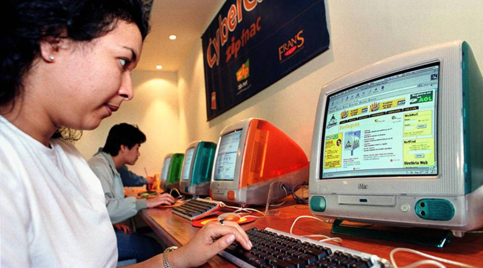 A Brazilian woman logs onto AOL at a cybercafe in Sao Paulo in 1999.