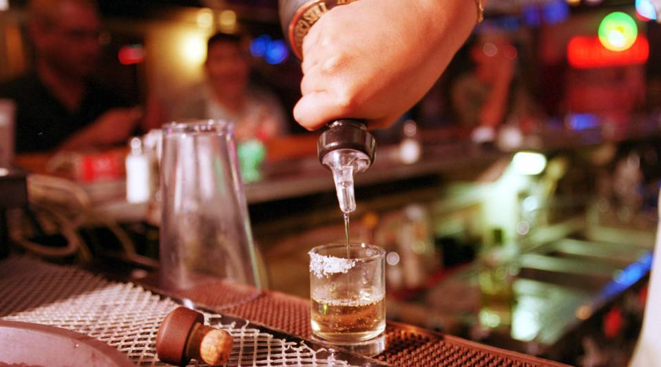 Office parties often include alcohol, but some companies are thinking about limiting drinks or even eliminating the bar this year.