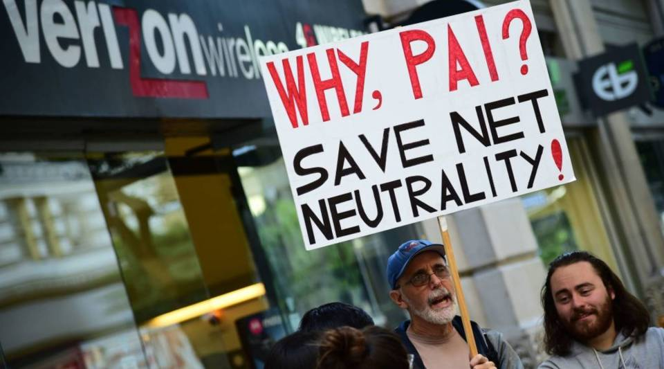 A small group of protestors supporting net neutrality protest against a plan by Federal Communications Commission (FCC) head Ajit Pai, during a protest outside a Verizon store on December 7, 2017 in Los Angeles, California.