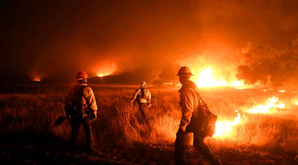 Firefighters light backfires as they try to contain the Thomas wildfire in Ojai, California, on Dec. 9.
