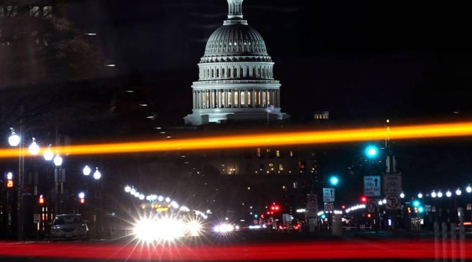 Traffic streaks past the U.S. Capitol on December 20, 2017 in Washington, DC.
