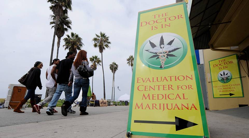 Signs advertising medical marijuana prescriptions outside an evaluation clinic on Venice Beach in Los Angeles on Oct. 9, 2009.