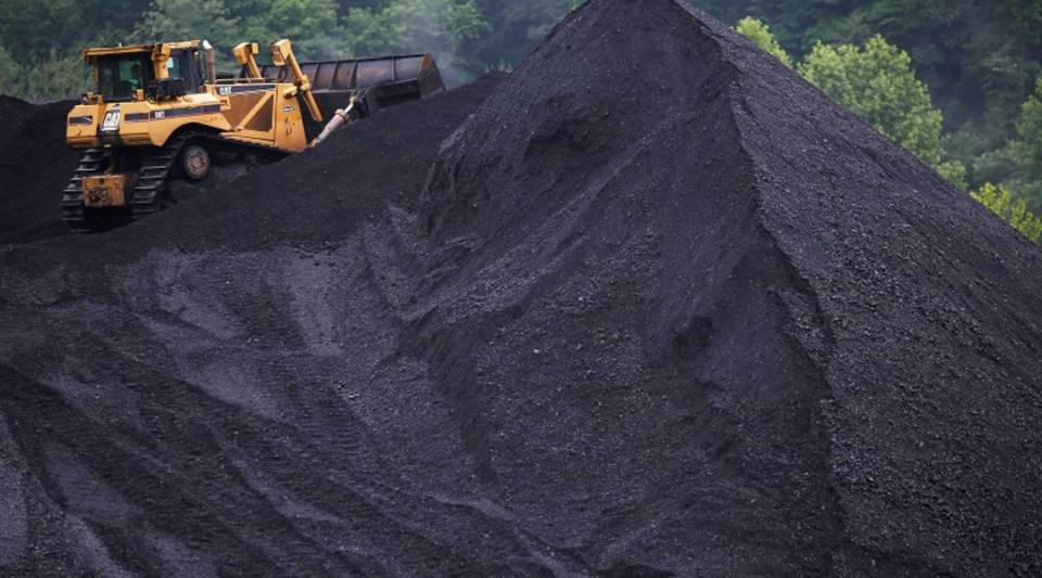Low natural gas prices will likely continue to keep the coal market weak. Above, a coal mound in Shelbiana, Kentucky.