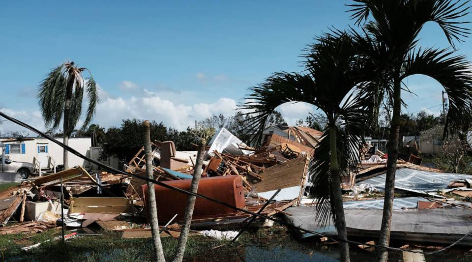 Flooded homes stand in a rural part of Naples, Florida the day after Hurricane Irma swept through the area.
