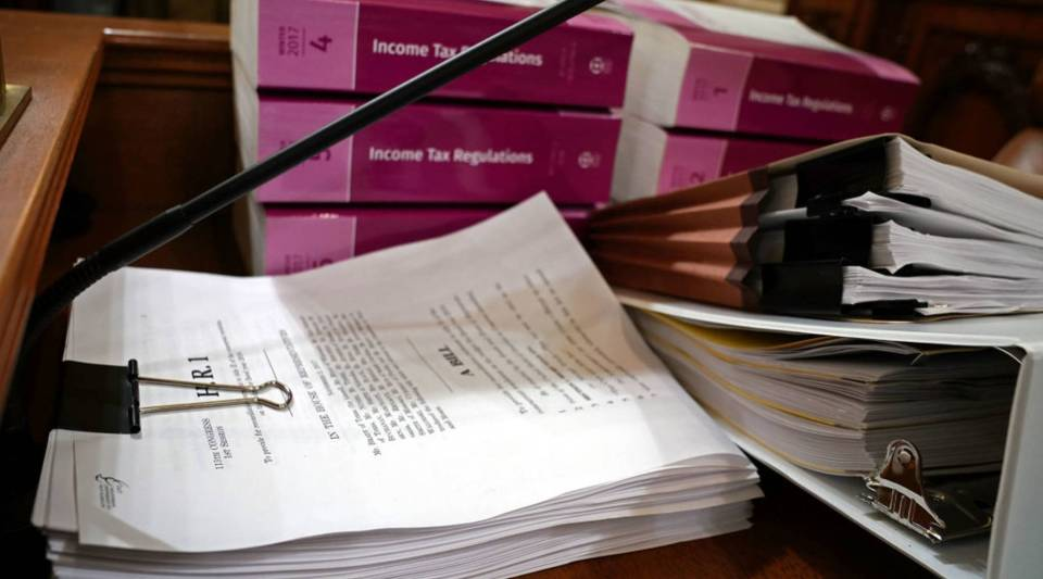 Legislation and regulation books related to the GOP's planned tax overhaul are stacked and ready in the House Ways and Means Committee hearing room in Washington, D.C.