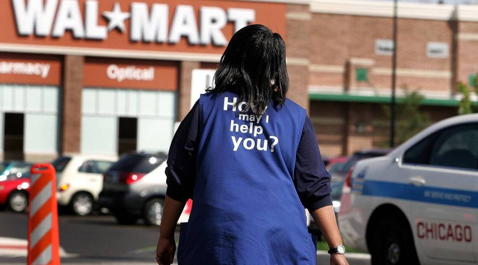 Walmart employee Anna Hines walks through the parking lot of a Walmart in Chicago, Illinois.