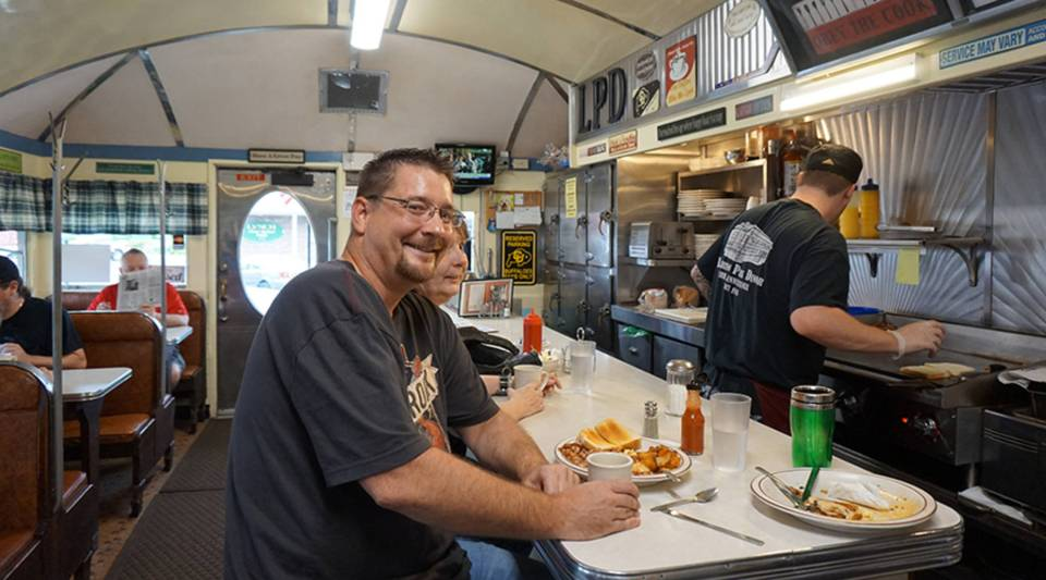 Jim Connelly, a former GE engineer, hopes to go back to school and start his own business. He sits at the Lawrence Park Dinor, just up the street from the 350-acre GE plant.