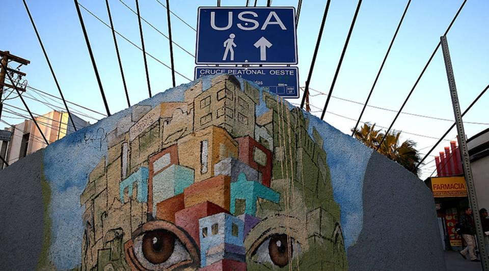 A sign directs pedestrians to the U.S. border crossing on Jan. 26, 2017 in Tijuana, Baja California. U.S.